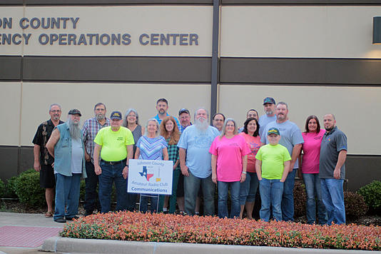 A group of various club members standing outside the Johnson County Emergency Operations Center.